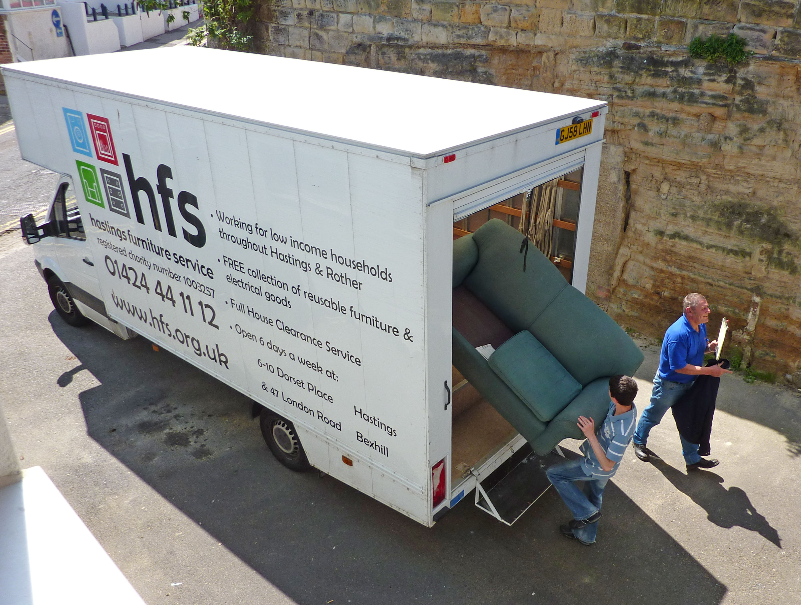 Photo of van being loaded with donated furniture