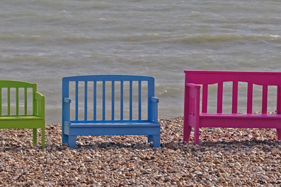 bright upcycled benches by the sea